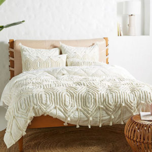boho cream quilt with tassels