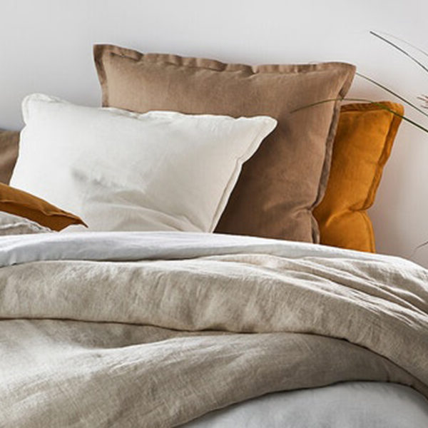 mixed linen pillows on bed