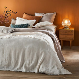 cream bedspread with frayed edges