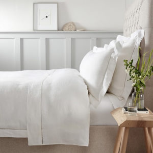 white linen bedding in profile