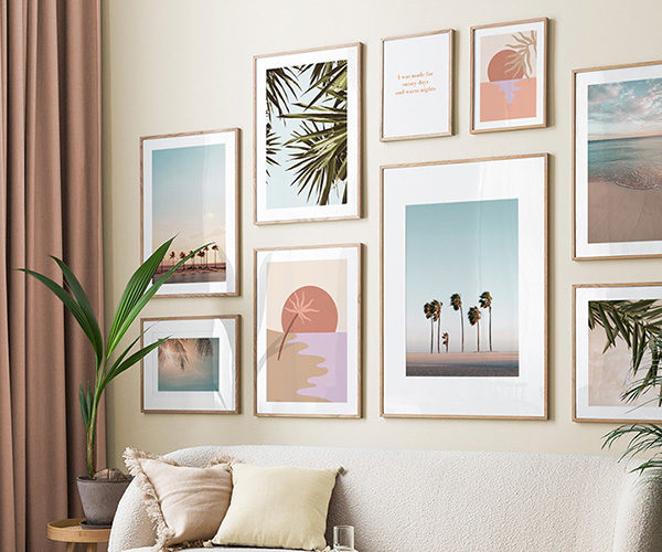 a gallery wall of sunset themed prints