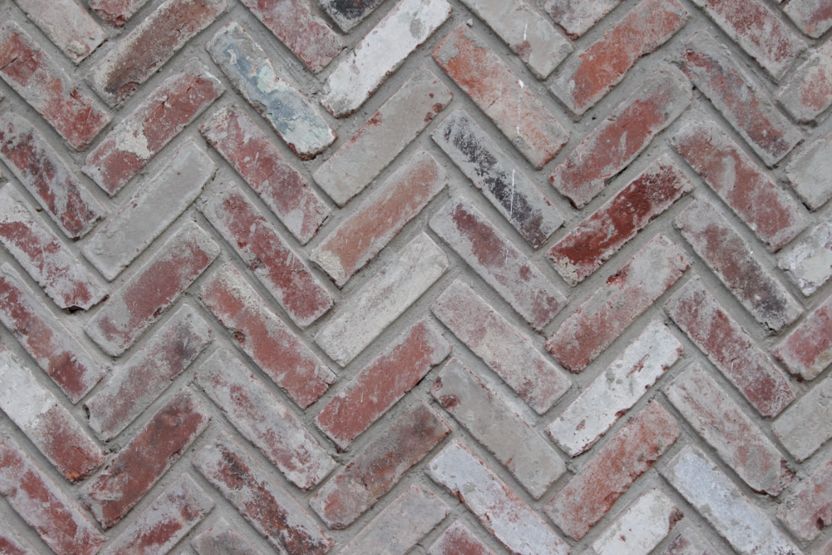 white washed brick slips in a herringbone pattern