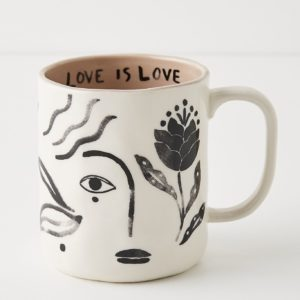 cream mug with black brush stroke illustrations