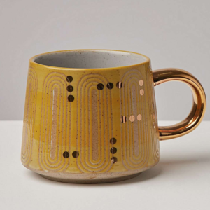 retro 70s style ochre and gold mug
